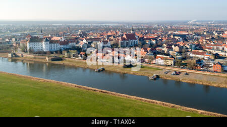 13 February 2018, Saxony, Torgau: View of the town with the castle Hartenfels (l) and the church St. Martin (r), (taken with a drone). The northern Saxon city will host the 9th Saxon State Garden Show in 2022 under the motto 'Torgau - Nature. Jesus. History'. The Torgauer Stadtpark, known as Glacis, is the centrepiece of the regional horticultural show. Photo: Jan Woitas/dpa-Zentralbild/ZB - Stock Photo