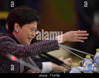 Beijing, China. 25th Mar, 2019. Carrie Lam Cheng Yuet-ngor, chief executive of Hong Kong Special Administrative Region (SAR), answers questions during the China Development Forum 2019 in Beijing, capital of China, March 25, 2019. The China Development Forum 2019 concludes on Monday. Credit: Li He/Xinhua/Alamy Live News - Stock Photo