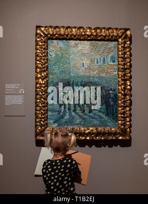 London, UK. 25th Mar, 2019. A girl looks at the painting 'The Prison Courtyard' by artist Vincent van Gogh during the preview for the Van Gogh and Britain exhibition at Tate Britain in London, Britain on March 25, 2019. The exhibition will be open from March 27 to August 11. Credit: Han Yan/Xinhua/Alamy Live News - Stock Photo
