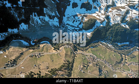 stunning Aerial top down views of a alpine river valley winding though the winter countryside in the central alps of Switzerland. - Stock Photo