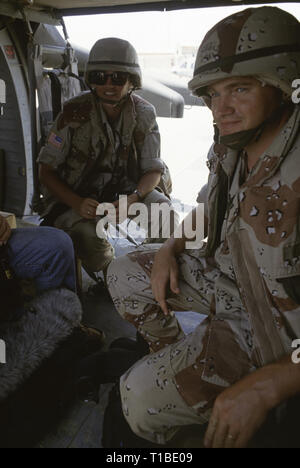 29th October 1993 Two U.S. Army soldiers seated inside an American Sikorsky UH-60 Black Hawk helicopter, about to take off from UNOSOM HQ in Mogadishu, Somalia. - Stock Photo