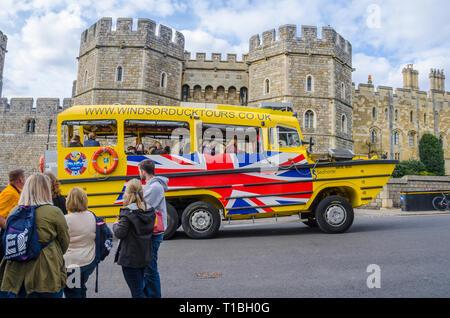 A Windsor Duck Tours amphibious vehicle drives past Windsor Castle. - Stock Photo
