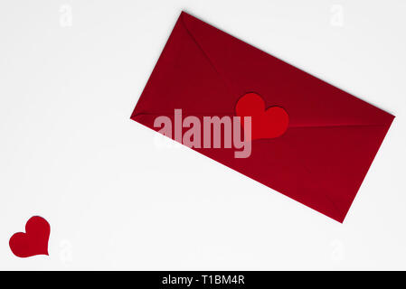 Concept of love letter in red envelope with romantic red hearts, all on white background with copy space. Happy Valentines. Mothers or Womens Day beau - Stock Photo