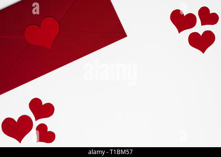 Concept of love letter in envelope. Romantic red hearts on white background as a frame for copy space. Happy Valentines. Mothers or Womens Day beautif - Stock Photo
