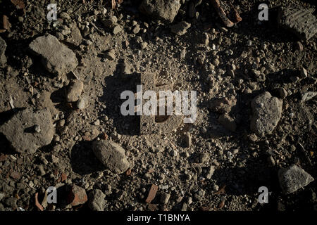 Turkish Lira Sign on Dirt of Building Debris in Harsh and Dark Shadow with Depressive Atmosphere. - Stock Photo