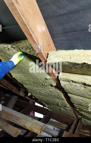 Man Installing Thermal Roof Insulation Layer Using