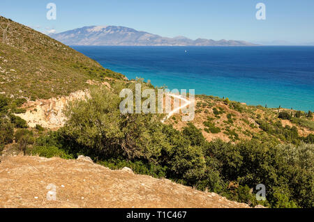 Colorful seascape from vacation in Greece with view on blue sea and another greek island on horizon. Vacation travel during sunny day on the hills wit - Stock Photo