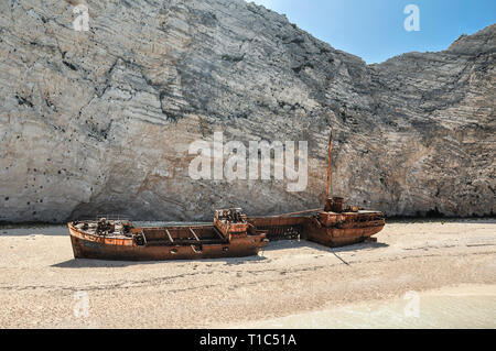 View from boat on the most famous and beautiful vacation summer beach in the world - Navagio on Zakynthos Island in Greece. Landscape of rock cliff an - Stock Photo