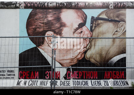 The famous Fraternal kiss graffiti: My God, Help Me to Survive This Deadly Love by Dmitri Vrubel on the Berlin Wall in Berlin, Germany. - Stock Photo