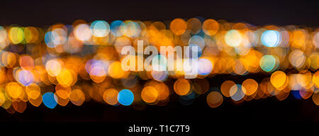 Blurred defocused city lights, Quito city, Ecuador. Abstract conceptual pattern as a banner expressing night city life, as wallpaper or background. - Stock Photo