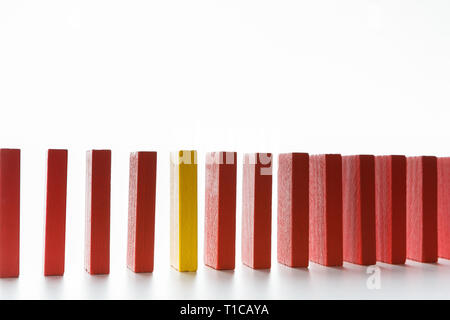 One red wooden block among yellow ones - Stock Photo