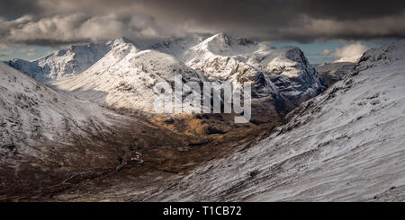 A Winter morning looking onto on The Three Sisters, Glencoe in the Scottish Higlands from the summit of Stob Mhic Mhartuin - Stock Photo