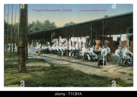 German historical postcard: army training base in Zeithain. infantry barracks, the soldiers eat in the open air, colored photo, world war one 1914-18 - Stock Photo