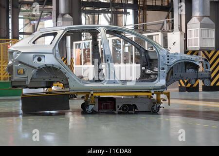 Russia, Izhevsk - December 15, 2018: LADA Automobile Plant Izhevsk, part of the AVTOVAZ Group. Frame construction of a new car . - Stock Photo