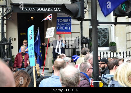 Brexit protest march, March 23, 2019, London. A Boris Johnson lookalike waves a Tories Against Brexit banner and salutes the crowd, a million strong. - Stock Photo