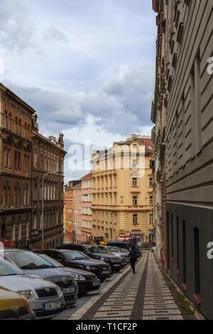 Prague, Czech Republic - September 22, 2018: quiet autumn old street of Prague with cars - Stock Photo