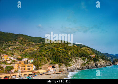 Scenic view of ocean and harbor in colorful village Monterosso, Cinque Terre national park, Liguria, Italy. Its one of five famous picturesque.