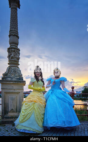 Anna and Elsa from the movie The Ice Princess on the Castle Bridge in Schwerin. - Stock Photo
