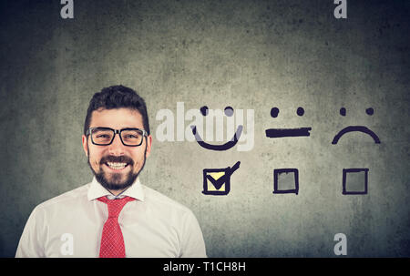 Customer experience concept. Confident happy business man received excellent rating for a satisfaction survey - Stock Photo