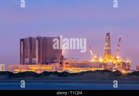 View over North Gare beach and dunes towards Hartlepool nuclear power station. UK. - Stock Photo