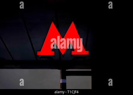 Moscow, Russia, February, 12, 2018. Emblem, the red letter 'M' of the Moscow metro on dark background. - Stock Photo