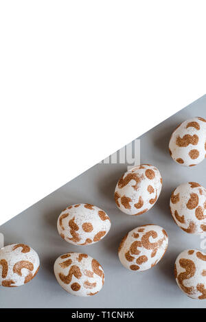 Stylish Frame background with gold and white easter eggs with copy space for text. Flat lay, top view. Easter concept. - Stock Photo