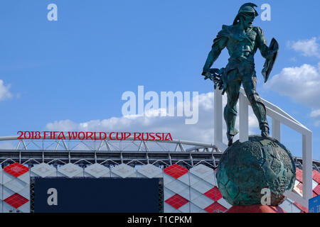 Moscow, Russia - May 30, 2018: Statue of gladiator on background of Spartak Stadium or 'Otkritie Arena'. - Stock Photo