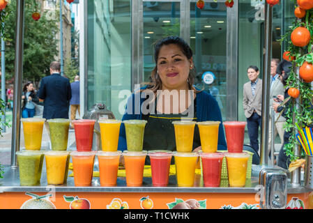 Santiago, Chile--April 6, 2018. A merchant selling fruit juices from her cart  in Santiago, Chile. Editorial use only. - Stock Photo