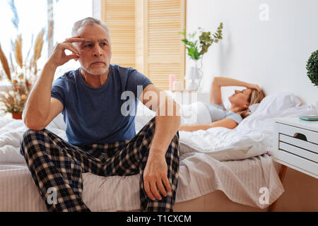 Dark-eyed mature man feeling bad after quarrel with his wife