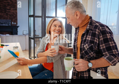 Couple of businessmen enjoying weekend morning at home - Stock Photo