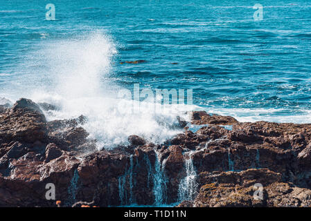 Ocean waves crashing against rocks, closeup. - Stock Photo