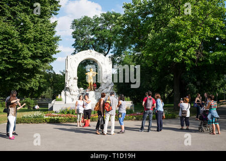 Johann Strauß II Monument in Stadtpark, Vienna with tourists taking photos on a sunny summer day. - Stock Photo
