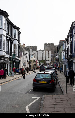 A view down Castle Street in the ancient town of Conwy in North Wales with Conwy Castle at the end - Stock Photo