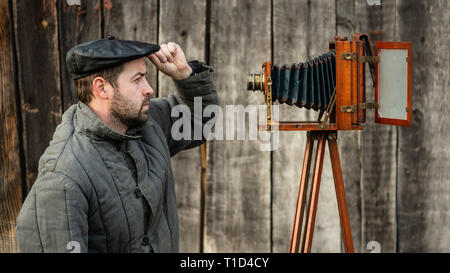 Selfie of old fashioned man on large format camera. Idea- retro photography - Stock Photo