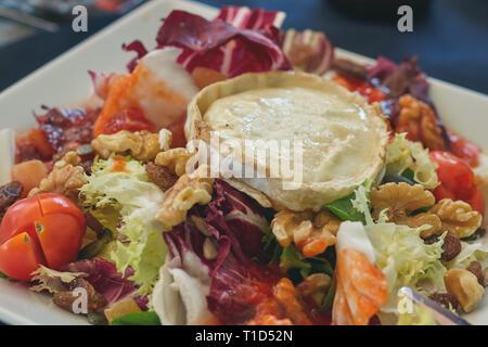 Fresh goat cheese salad on the Spanish restaurant - Stock Photo