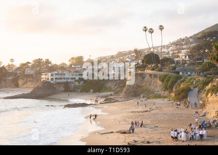 Sunset view of cliffs and beach from Heisler Park in Laguna Beach, Orange County, California - Stock Photo