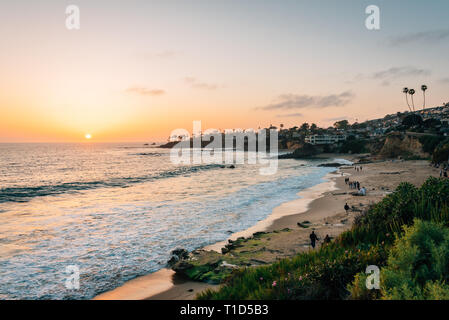 View of beach and cliffs at sunset, from Heisler Park, in Laguna Beach, Orange County, California - Stock Photo