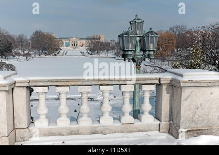Scenic winter landscape of Wade Park and Pond in Cleveland, Ohio, USA after a January snowfall near the Cleveland Museum of Art. - Stock Photo