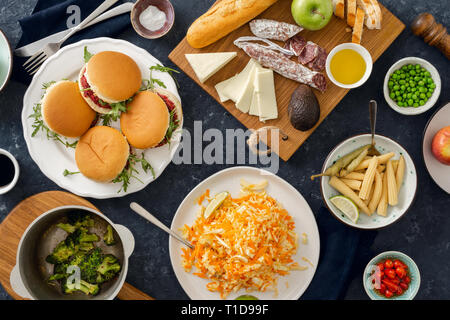 Summer party food concept top view. Various food on table flat lay. Vegetarian burgers with different foods. Vegetarian food is not only - Stock Photo