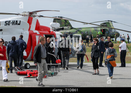 Sikorsky S-76C+ Search and Rescue helicopter and HKP 4 Swedish version of Boeing Vertol CH-46 Sea Knight during Marinens Dag (Navy Day) in Karlskrona  - Stock Photo