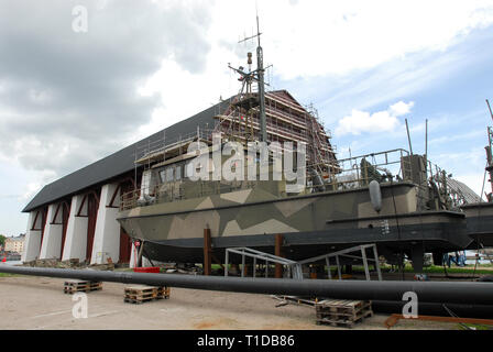 HMS Viggen (B04) and Vasaskjulet (Wasa Shed) from XVIII century in Navy Yard and Karlskrona örlogsbas (Karlskrona naval base) listed World Heritage by - Stock Photo