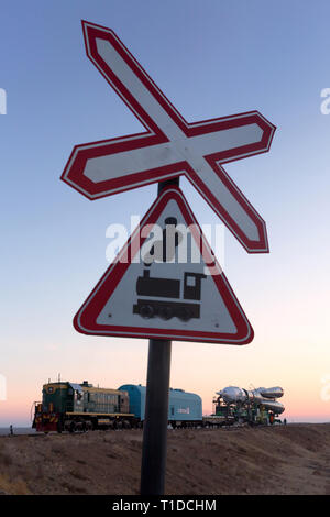 BAIKONUR - The Soyuz rocket MS-03 is beeing rolled out by train to the Gagarin Start launchpad on monday and is seen at a train crossing. - Stock Photo