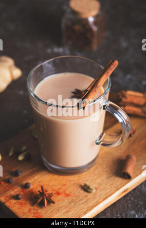 Flavoured tea chai made by brewing black tea with aromatic spices and herbs - Stock Photo