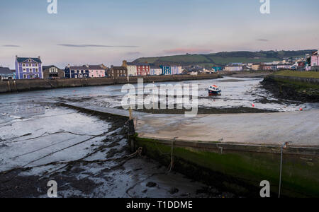 A single boat, in Aberaeron harbour, on the west coast of Wales - Stock Photo