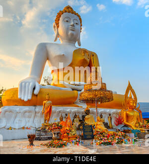 Huge statue of seated Buddha at What Phra That Doi Kham in Chaing Mai - Stock Photo