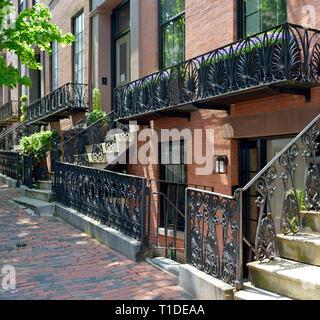 Iron fence, railings and balcony in Beacon Hill, Boston. Decorative design, colonial Boston - Stock Photo