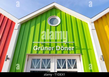 North Sea island Langeoog, East Frisia, Lower Saxony, colorful facades of shops, restaurants, beach stalls, - Stock Photo