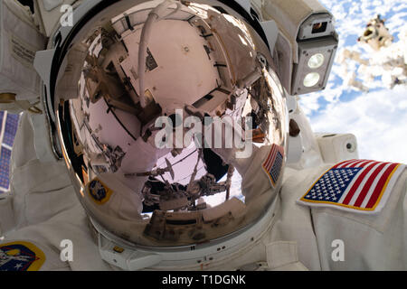 Expedition 59 NASA astronaut Nick Hague takes a selfie while working on the power supply during a spacewalk outside the International Space Station March 22, 2019 in Earth Orbit. Astronauts McClain and Hague spent six-hours and 39-minutes outside the space station to upgrade the orbital complex's power storage capacity. - Stock Photo