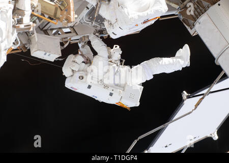 Expedition 59 NASA astronaut Nick Hague works on the power supply during a spacewalk outside the International Space Station March 22, 2019 in Earth Orbit. Astronauts McClain and Hague spent six-hours and 39-minutes outside the space station to upgrade the orbital complex's power storage capacity. - Stock Photo
