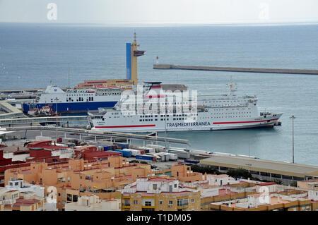 Ferries bound for Morocco and Algeria in commercial port of Almeria city in Almeria, Spain. - Stock Photo